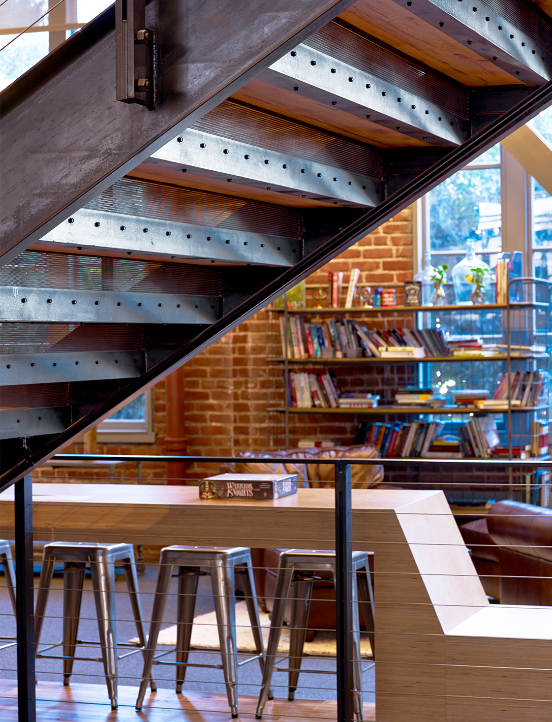 Heroku Office Interior Stairs with Metal Detailing and Stools