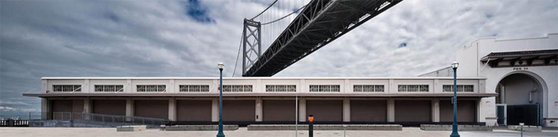 Pier 24 Pilara Foundation Exterior Facade Straight On with Bridge
