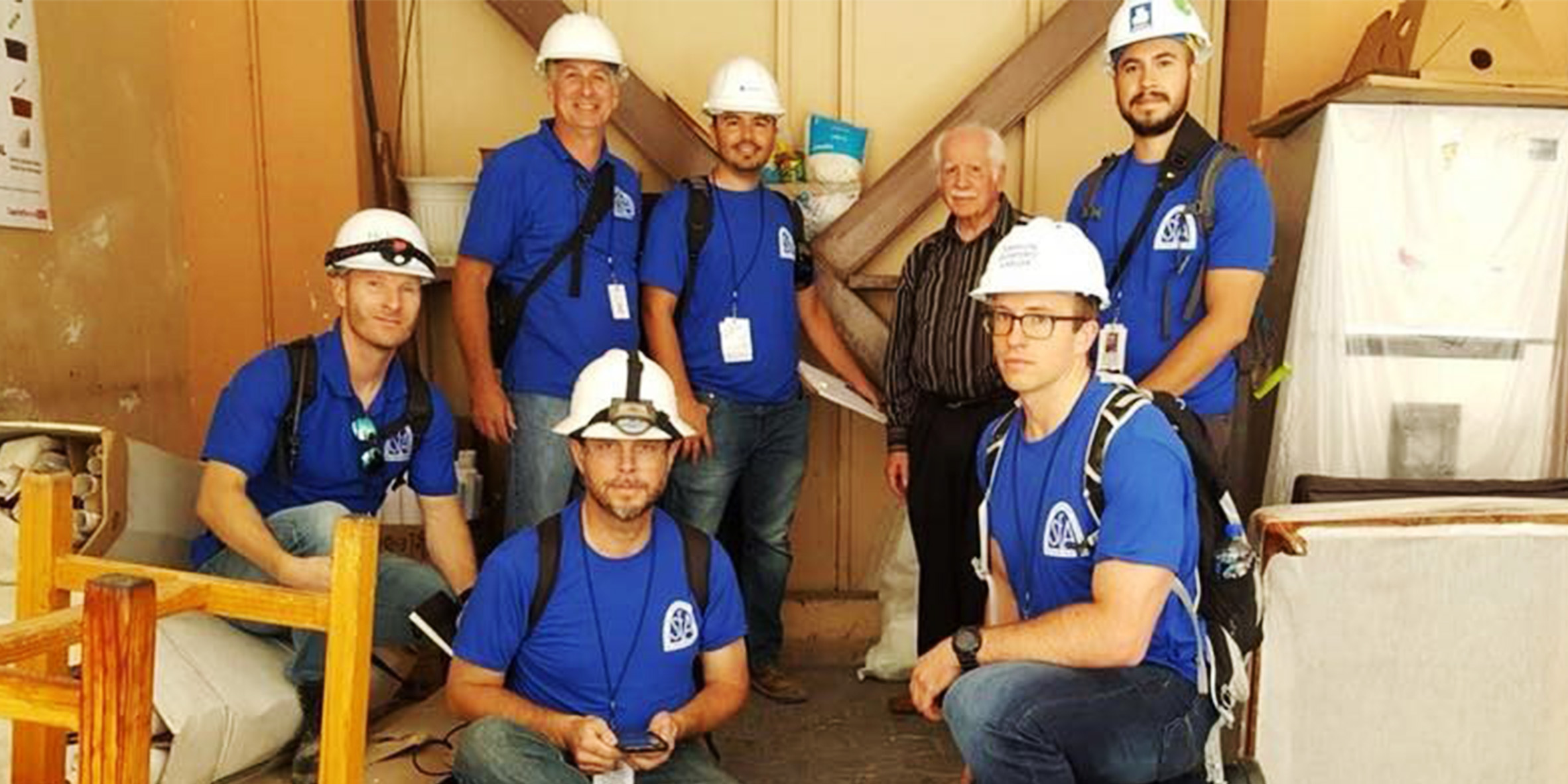 SEAOSC Safer Cities Team in Helmets with Building Owner featuring Dion Marriott, Ken O'Dell, Marty Hudson, Daniel Zepeda, Building Owner, Russell McLellan, Raul Jimenez