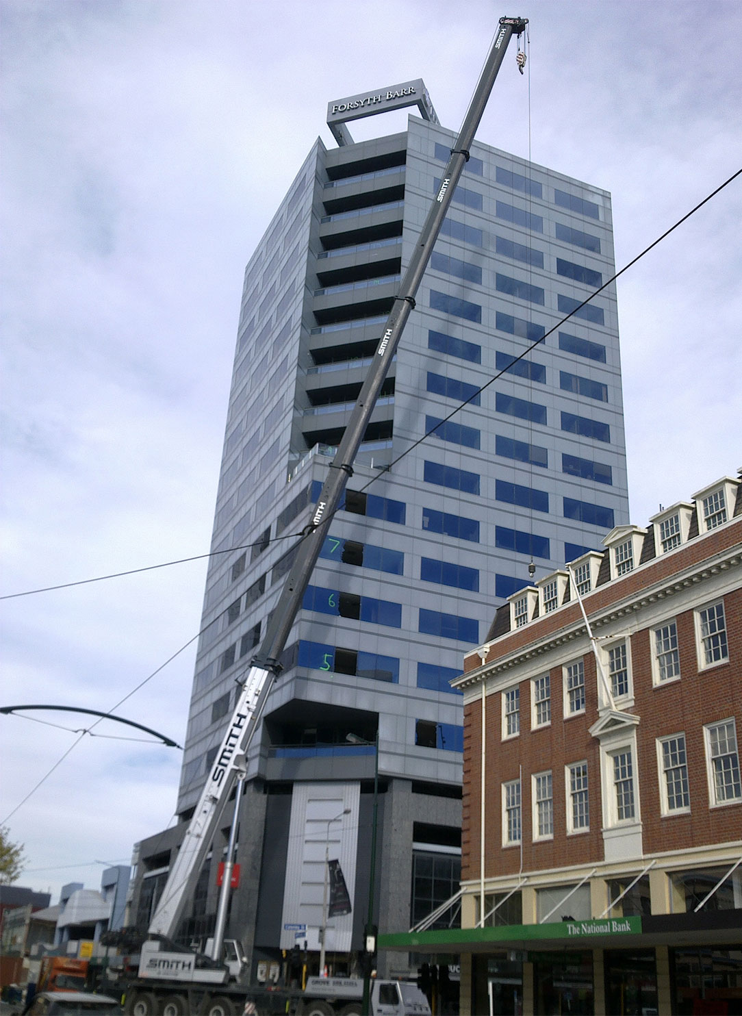 A crane helps occupants escape at Forsyth Barr